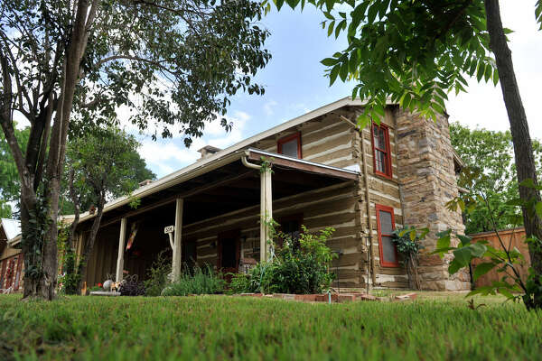 Two log cabins, dating from 1755 and early 1800s, were hauled to San Antonio in 1952 and re-formed to make one house. It was purchased in 2010 by Rose Perez.