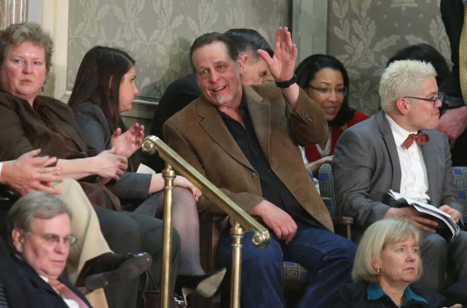 Musician and gun rights advocate Ted Nugent (C) attends U.S. President Barack Obama's State of the Union address before a joint session of Congress February 12, 2013 in Washington, DC. Rep. Steve Stockman (R-TX) invited Nugent as his guest for the President's speech.