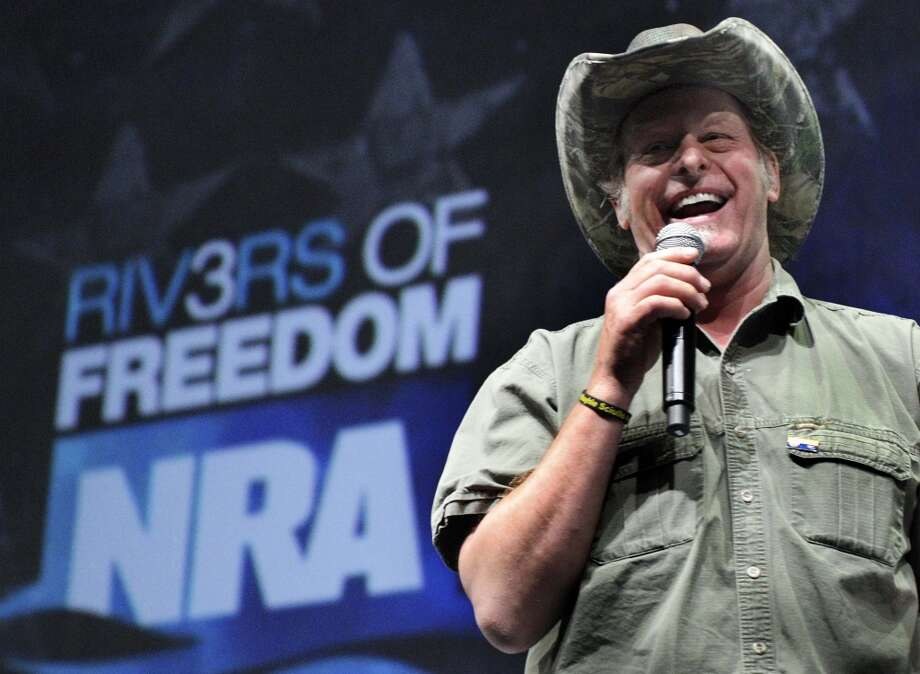 "In this May 1, 2011 file photo, musician and gun rights activist Ted Nugent addresses a seminar at the National Rifle Association's convention in Pittsburgh. Rep. Steve Stockman , R-Texas, says he's invited Nugent, who has referred to President Barack Obama's administration as ""evil, America-hating,"" to Tuesday's State of the Union address."