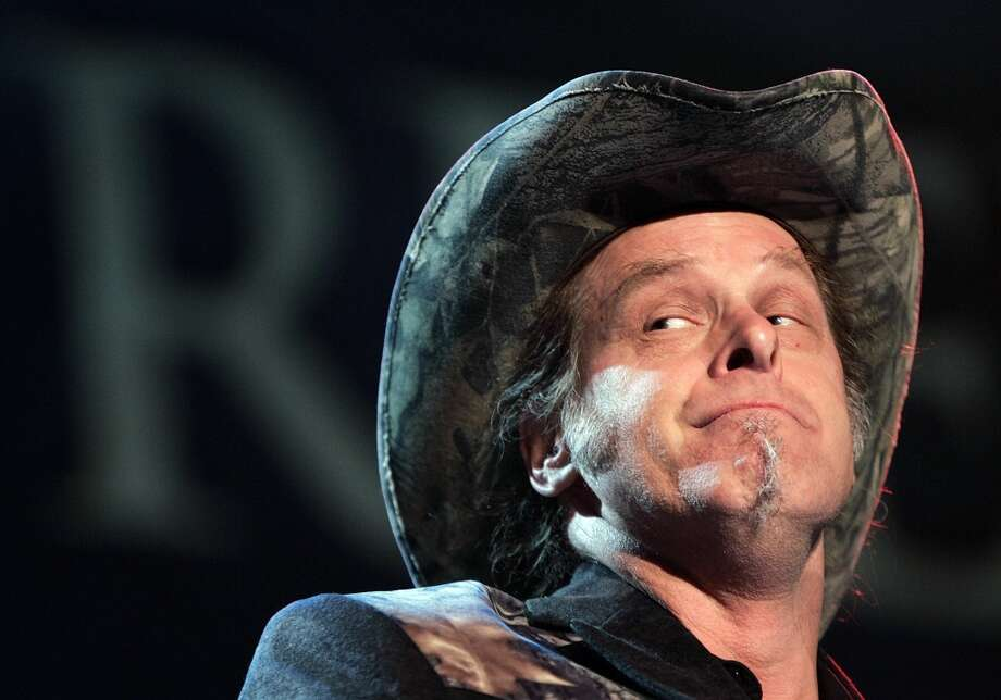In this May 19, 2006 file photo, Ted Nugent performs during the opening ceremony of the National Rifle Association annual convention  in Milwaukee.  Nugent conducted an estate sale over the weekend, peddling big game trophies to make relocation to a nearby Texas ranch a bit easier.