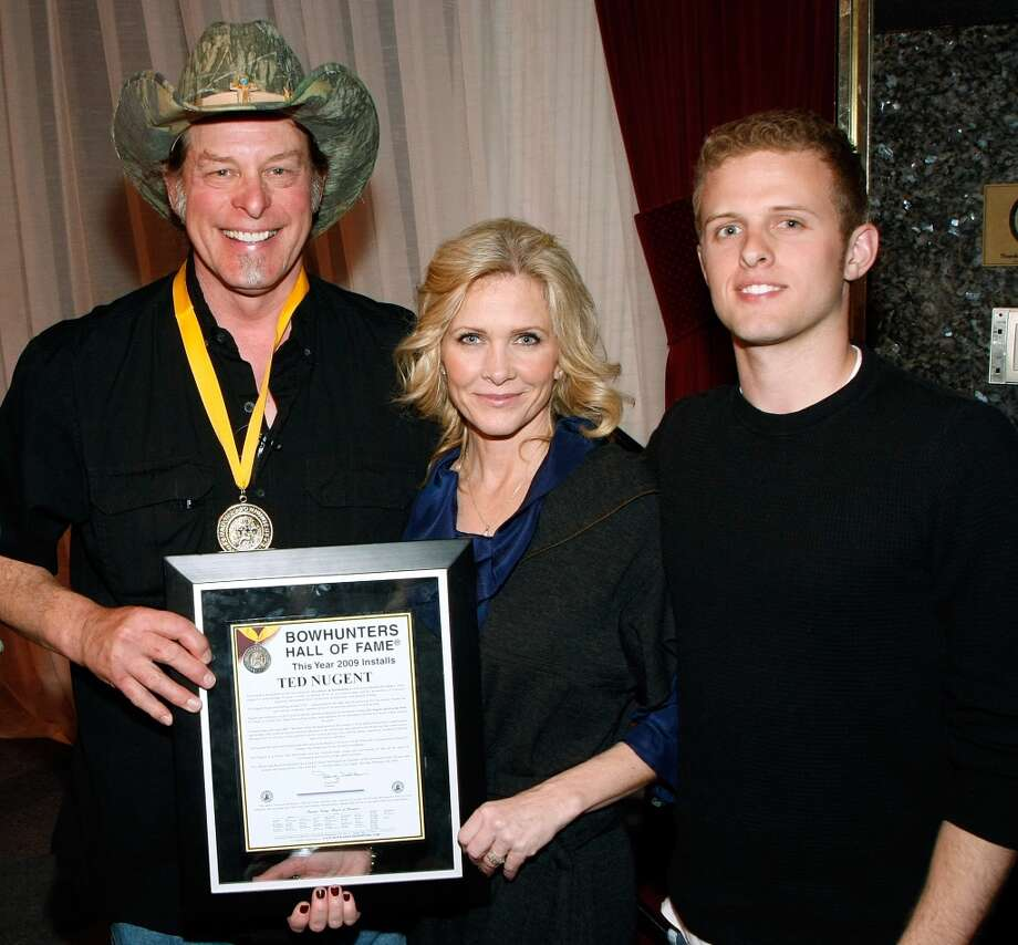 LAS VEGAS - FEBRUARY 06:  Music artist Ted Nugent, his wife Shemane Nugent and son Rocco Nugent appear after Ted Nugent was inducted into the National Bowhunters Hall of Fame during the National Field Archery Association's World Archery Festival at the Riviera Hotel & Casino February 6, 2009 in Las Vegas, Nevada. Nugent was inducted in the Excellence in Bowhunting and Literary Excellence categories.