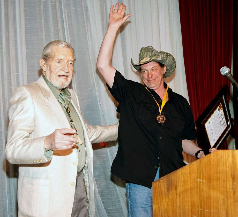 """National Bowhunter Magazine"" publisher and editor Doug Walker (L) inducts music artist Ted Nugent into the National Bowhunters Hall of Fame during the National Field Archery Association's World Archery Festival at the Riviera Hotel & Casino February 6, 2009 in Las Vegas, Nevada. Nugent was inducted in the Excellence in Bowhunting and Literary Excellence categories."