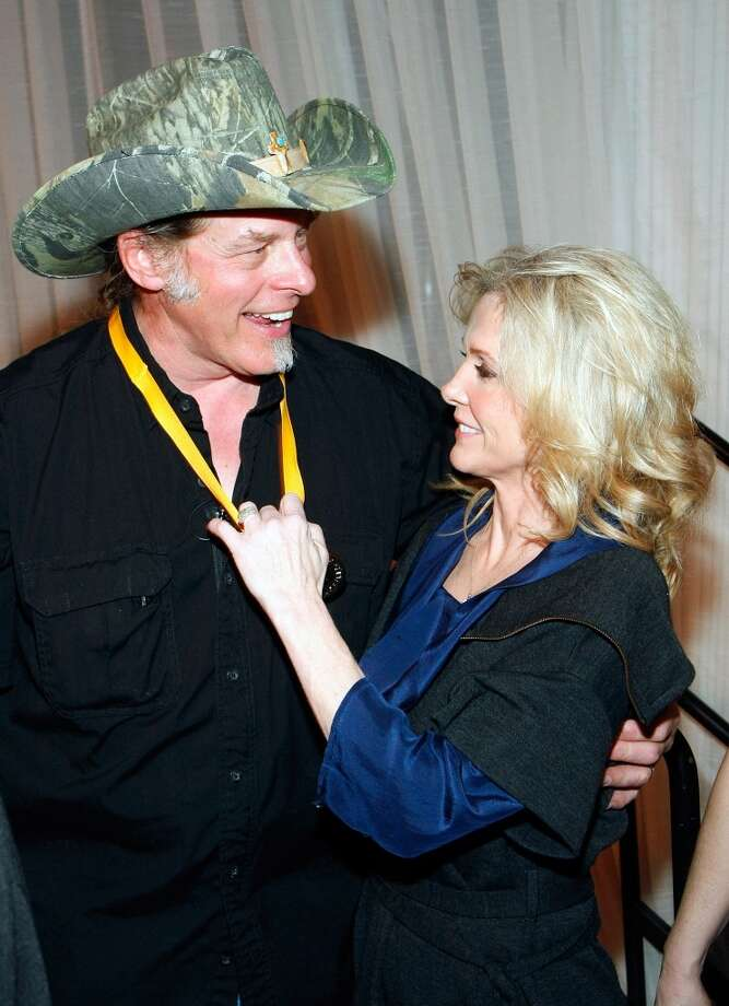 Music artist Ted Nugent and his wife Shemane Nugent appear after he was inducted into the National Bowhunters Hall of Fame during the National Field Archery Association's World Archery Festival at the Riviera Hotel & Casino February 6, 2009 in Las Vegas, Nevada. Nugent was inducted in the Excellence in Bowhunting and Literary Excellence categories.  (Photo by Ethan Miller/Getty Images)