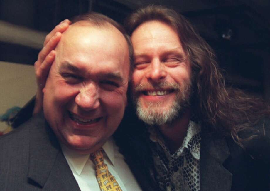 Michigan Gov. John Engler and rocker Ted Nugent ham it up backstage at Nugent's 50th birthday bash at the State Theater in Detroit Thursday, Dec. 17, 1998. Nugent turned 50 Dec. 13.