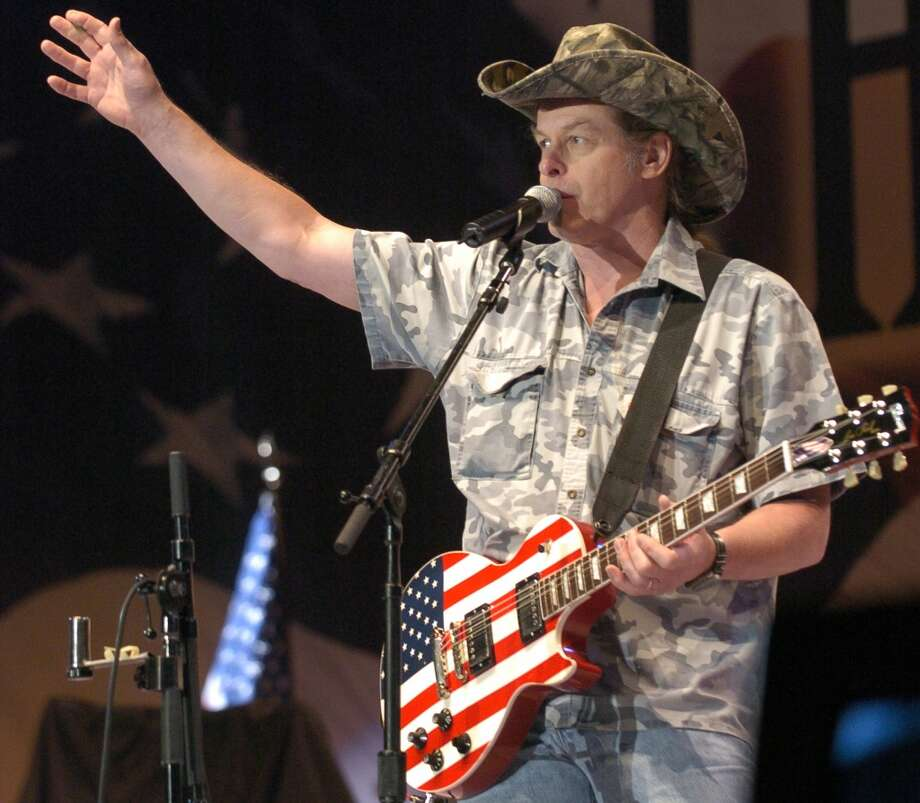 4/15/2005-Opening ceremony of the the 2005 NRA Annual Meeting in the George R. Brown Convention Center, Friday, was highlighted with a performance by NRA board member and rock'n'roller Ted Nugent performing a solo rendition of the Star Spangled Banner on his guitar embelished with Old Glory.