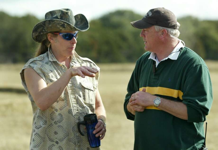"Musician, author and outdoor enthusiast Ted Nugent, left, talks with director Glenn Taylor on the set of his TV show, ""Surviving Nugent"" on Saturday afternoon, January 17, 2004 near China Springs, Texas. (mvw) 2004"