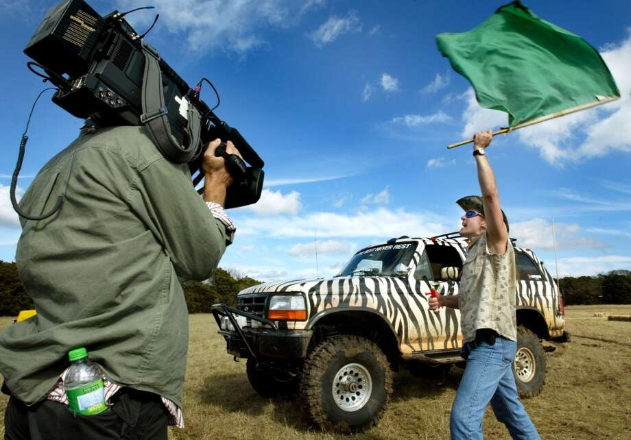"Musician, author and outdoor enthusiast Ted Nugent starts a demolition derby segment for his show, ""Surviving Nugent"" on Saturday afternoon, January 17, 2004 on his ranch near China Springs, Texas. (mvw) 2004"