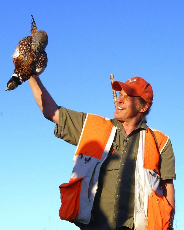 FILE -- In an Oct. 15, 2010 file photo Ted Nugent holds up a rooster pheasant he shot at the Dakota Hills Shooting Preserve in Oral, S.D.  Nugent met with Michigan Gov. Rick Snyder Thursdsay March 31, 2011 to seek loosening of hunting regulations.  (AP Photo/Rapid City Journal, Aaron Rosenblatt)