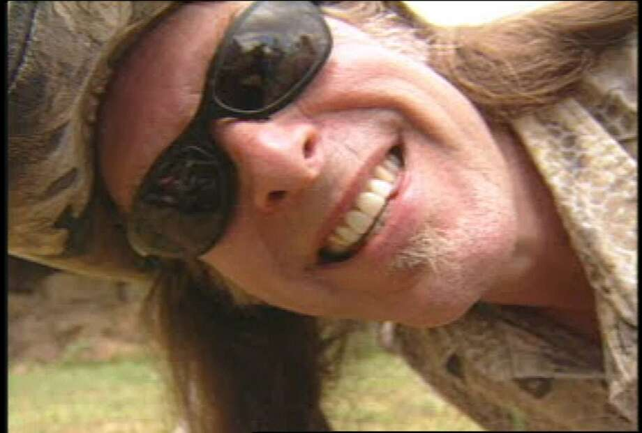 "Ted Nugent is shown in a 2003 handout photo in Jackson County, Mich.  ""Surviving Nugent,"" a two-hour reality program that airs Sunday, Oct. 5, 2003, on VH1 features the outspoken rocker and outdoors enthusiast.  (AP Photo/VH1, handout)  HOUCHRON CAPTION  (10/04/2003):  Surviving Nugent, a two-hour reality program that airs Sunday night, features outspoken rocker Ted Nugent as well as outdoors enthusiasts."