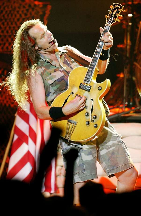 Rocker Ted Nugent performs Monday, Aug. 11, 2003, at the Illinois State Fair in Springfield, Ill.