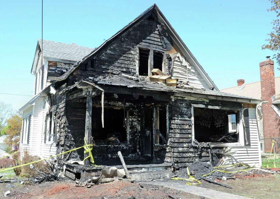 An overnight fire in this house at 15 Bellmead St. left five people injured on Friday, May 3, 2013 in Wynantskil, N.Y. (Lori Van Buren / Times Union) Photo: Lori Van Buren / 10022275A