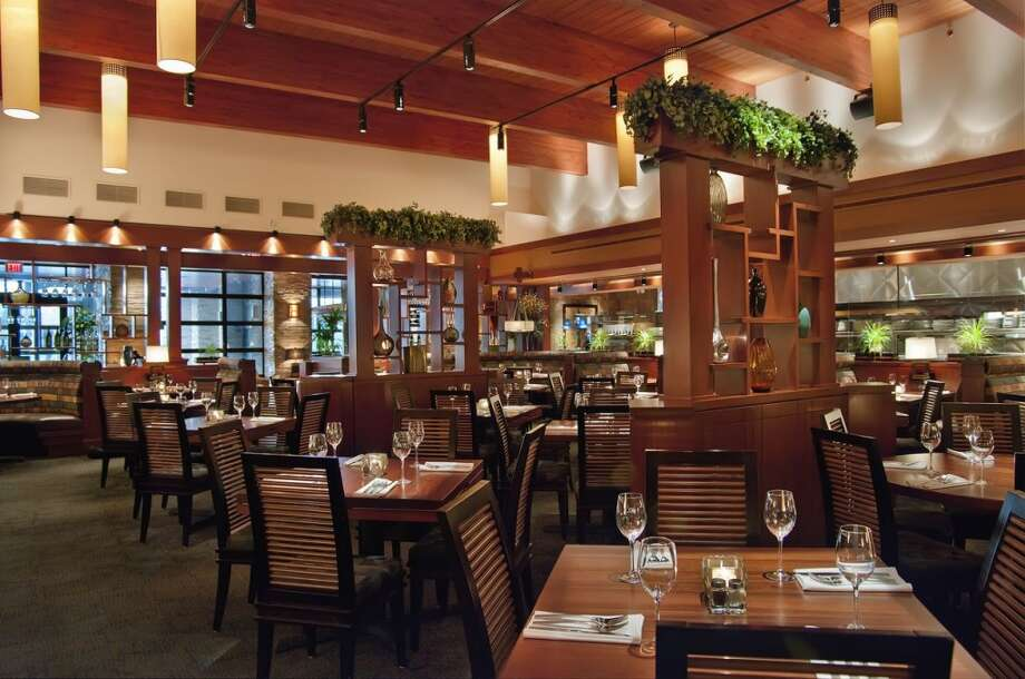 Seasons 52 will open its first Houston location at Millennium High Street on Westheimer. An example of the dining room is shown. The Florida-based chain has 30 restaurants in 15 states.
