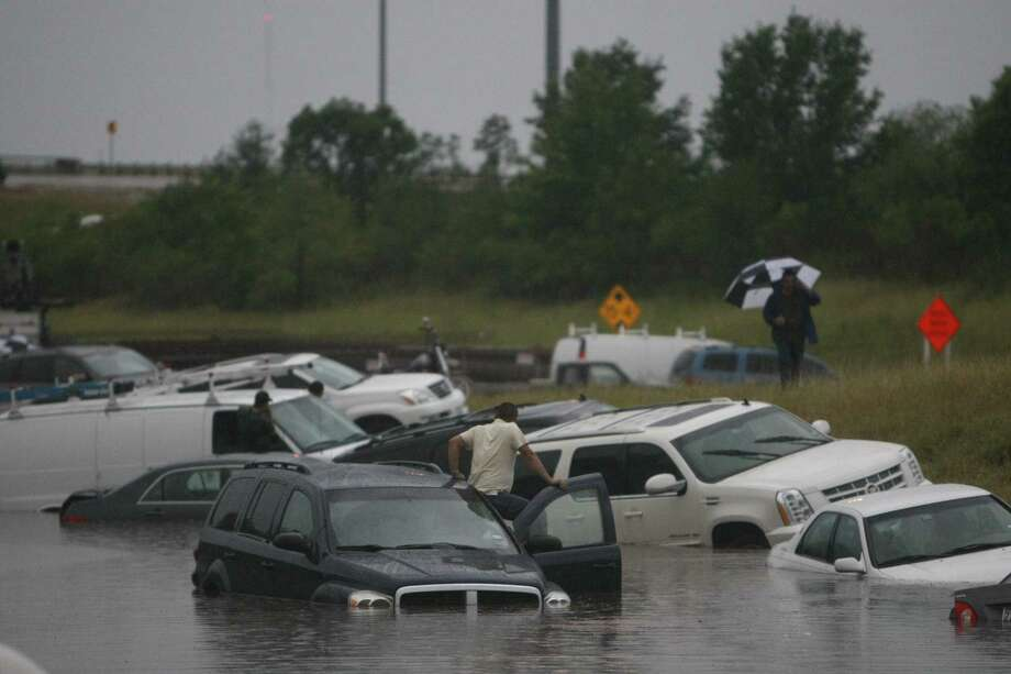 Houston officially received a quarter-inch of rain last weekend at Bush Intercontinental. Meanwhile, cars and people were stranded in floodwaters on U.S. 288 near Loop 610. Photo: UWN