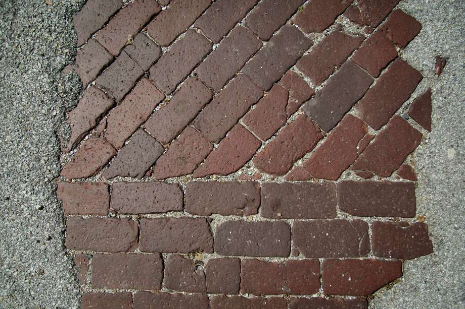 """Those brick streets are the defining element of Freedmen's Town. There's no more room for compromise. Everything else has been compromised away,"" says Catherine Roberts, a board member of the Rutherford B.H. Yates Museum. Photo: Michael Paulsen, Staff / © 2013 Houston Chronicle"