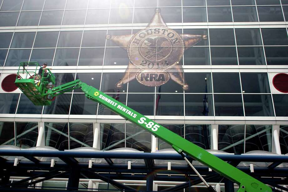 The National Rifle Association's 142 Annual Meetings and Exhibits logo is placed on the George R. Brown Convention Center Wednesday, May 1, 2013, in Houston. 