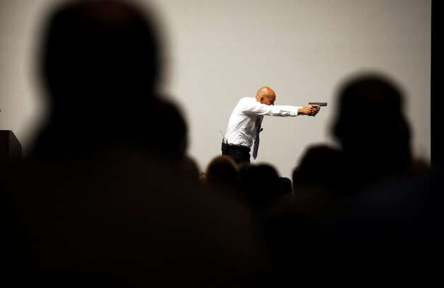 Rob Pincus teaches a course on shooting skills at the NRA convention, Friday, May 3 at the George R. Brown Convention Center in Houston. Photo: Johnny Hanson/Chronicle