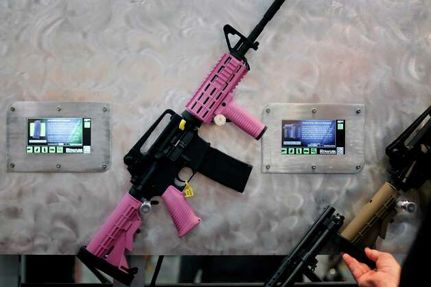A rifle painted pink is seen, during day 1 of the 142nd NRA annual meetings and exhibits, Friday, May 3, 2013 at the George R Brown convention center in  (TODD SPOTH FOR THE CHRONICLE) Photo: © TODD SPOTH, 2013 / © TODD SPOTH, 2013