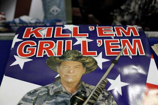 A stack of posters featuring Ted Nugent is seen, during day 1 of the 142nd NRA annual meetings and exhibits, Friday, May 3, 2013 at the George R Brown convention center in  (TODD SPOTH FOR THE CHRONICLE) Photo: © TODD SPOTH, 2013 / © TODD SPOTH, 2013