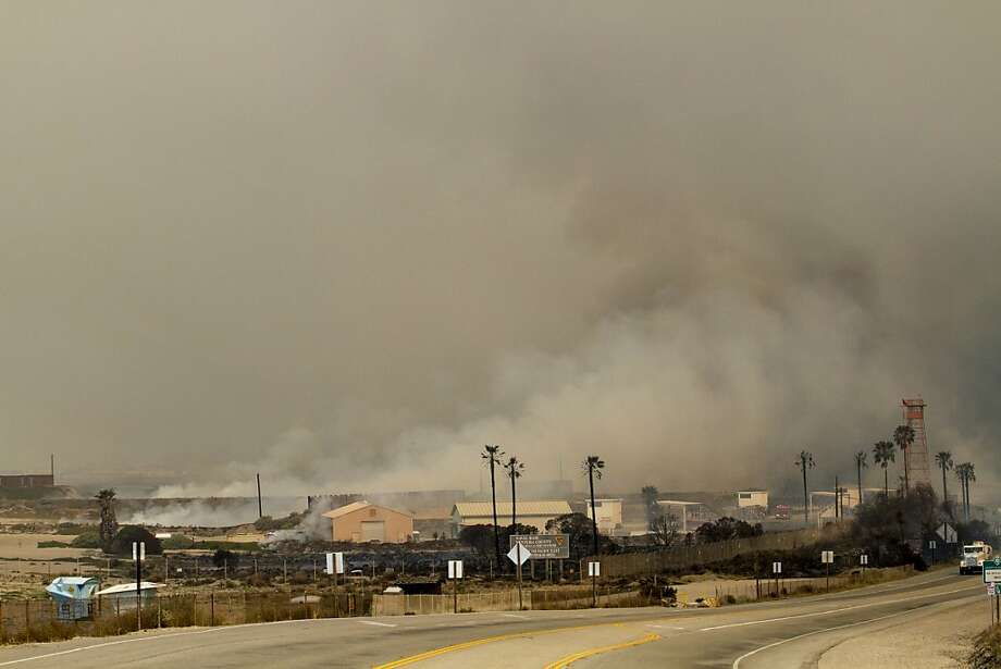 Smoke rises from the Naval Base at Point Mugu Friday, May 3, 2013. The 15 1/2-square-mile blaze was only 10 percent contained on Friday, and the work of more than 900 firefighters, aided by air tankers, was just beginning.  Photo: Ringo H.W. Chiu, Associated Press