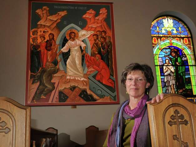 Marie Giokas sits in a pew under the Resurrection of Christ painting at St. Basil's Russian Orthodox Church on Monday, April 29, 2013 in Watervliet, N.Y.  (Lori Van Buren / Times Union) Photo: Lori Van Buren / 10022172A