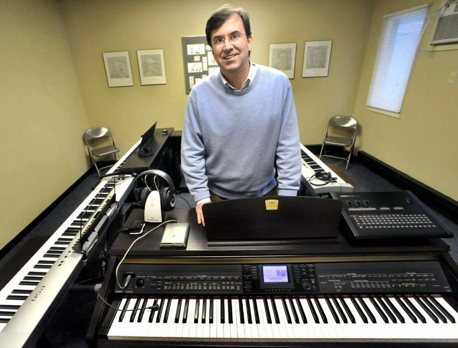 Jeff McGill, Director of The Music Learning Center, in the Yamaha Digital Piano Lab, of the Danbury business, on Monday, Jan.4,2010. Photo: Michael Duffy / The News-Times