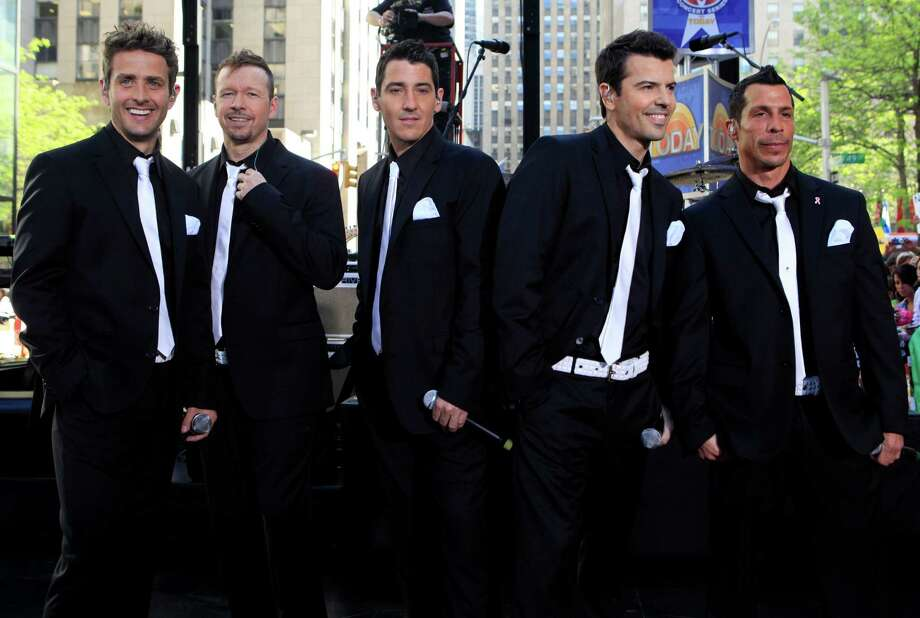 "FILE - This May 8, 2009 file photo shows members of New Kids on the Block, from left, Joey McIntyre, Donnie Wahlberg, Jonathan Knight, Jordan Knight, and Danny Wood on the NBC ""Today"" television program in New York. The New Kids on the Block, Aerosmith, James Taylor, and Jimmy Buffett are among the scheduled performers for a Boston Marathon benefit concert May 30. The show, at the TD Garden, will benefit One Fund _ the collection of donations that will be distributed to the survivors of the April 15 bombings and the families of those killed in the attack.""  (AP Photo/Richard Drew) Photo: Richard Drew"