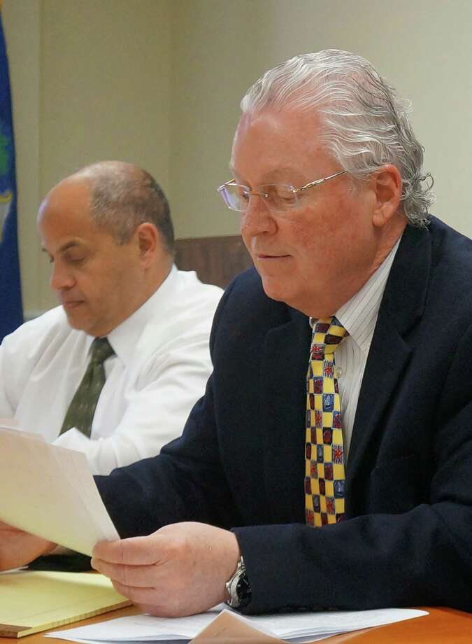 First Selectman Mike Tetreau, flanked on his left by Public Works Director Joseph Michelangelo, announced Friday that another $700,000 could be cut from the town's $280 million spending plan, dropping the tax increase to 2.78 percent. Photo: Genevieve Reilly / Fairfield Citizen