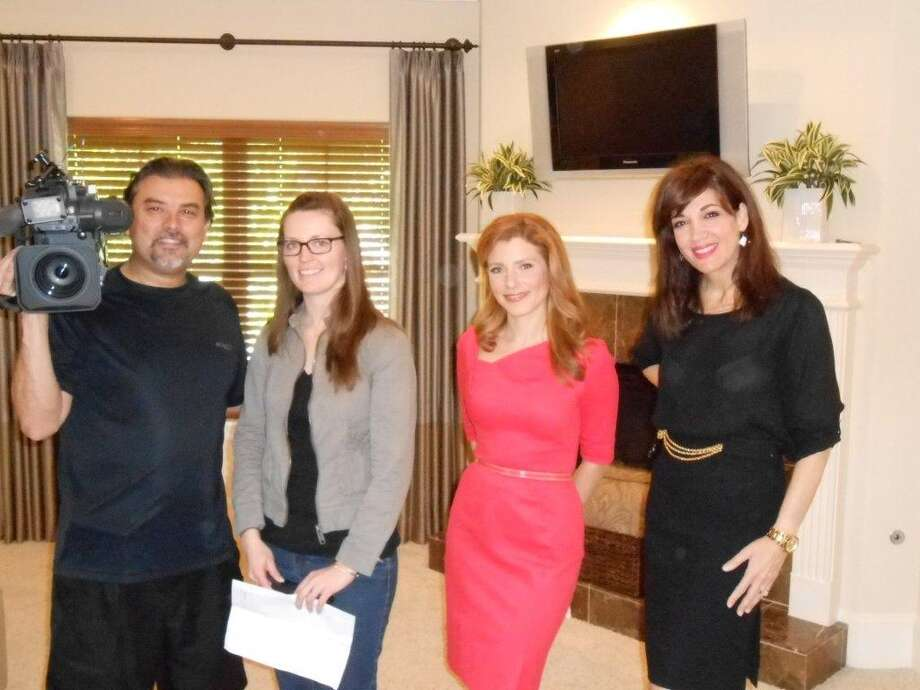 Participating in the CNBC production were, from left, local photographer Joe Vasquez, CNBC producer Erin Barry, CNBC reporter Julia Boorstin and John Daugherty, Realtors agent Lisa Kornhauser.