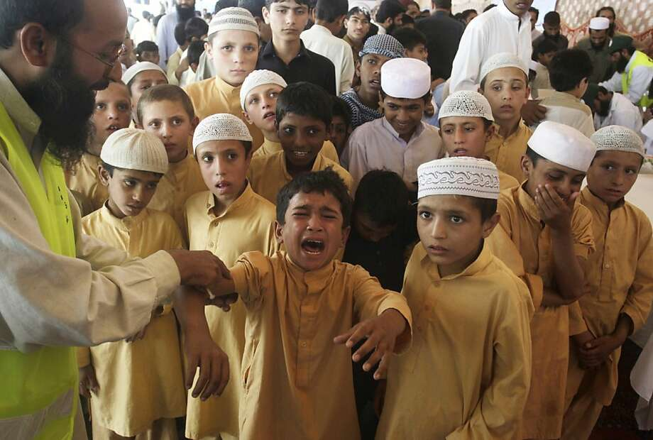 OK, who's next?! A Pakistani boy screams in pain after getting a measles shot, raising 