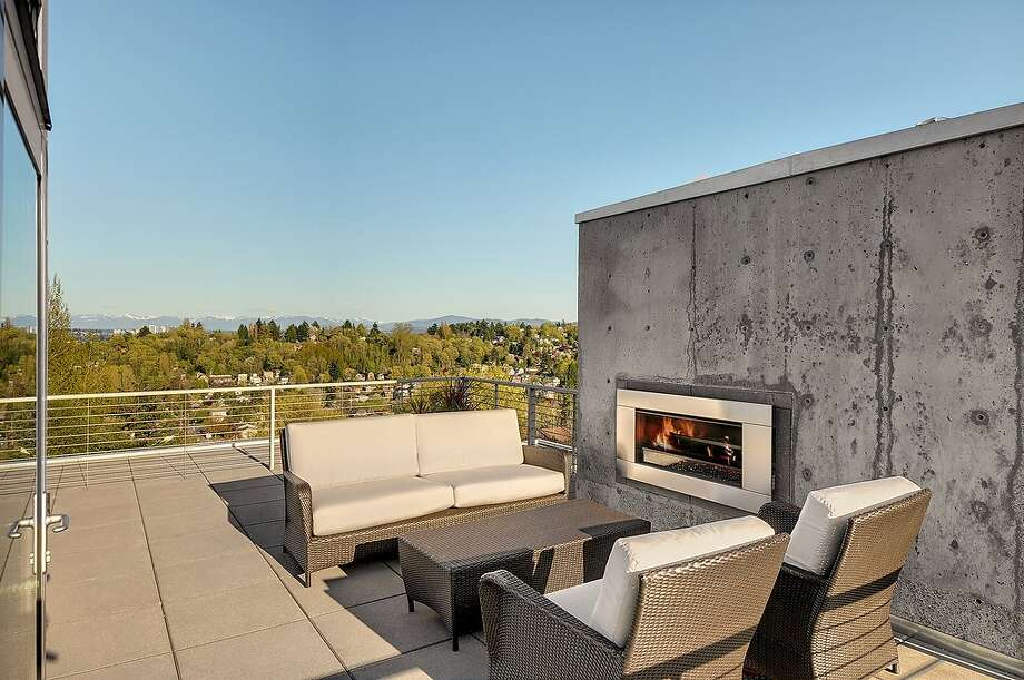 Roof deck of 315 25th Ave. E. The 3,183-square-foot house, built in 2008, has three bedrooms, 2.75 bathrooms, a family room, walls of windows, concrete floors and walls, patios and a balcony on a 6,400-square-foot lot. It's listed for $1.395 million, although a sale is pending. Photo: Courtesy Phillip Belenky, Coldwell Banker Bain