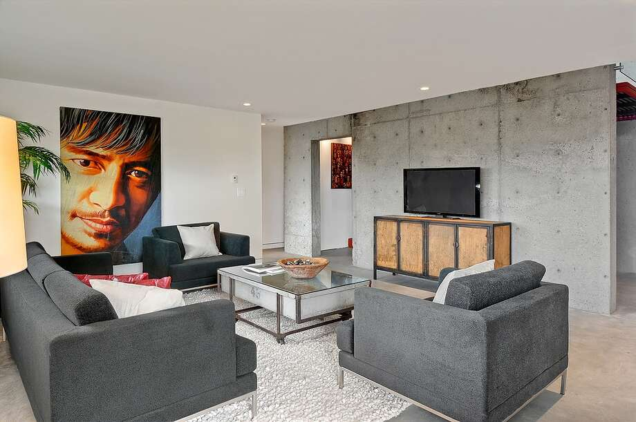 Family room of 315 25th Ave. E. The 3,183-square-foot house, built in 2008, has three bedrooms, 2.75 bathrooms, walls of windows, concrete floors and walls, a roof deck with a fireplace, patios and a balcony on a 6,400-square-foot lot. It's listed for $1.395 million, although a sale is pending. Photo: Courtesy Phillip Belenky, Coldwell Banker Bain