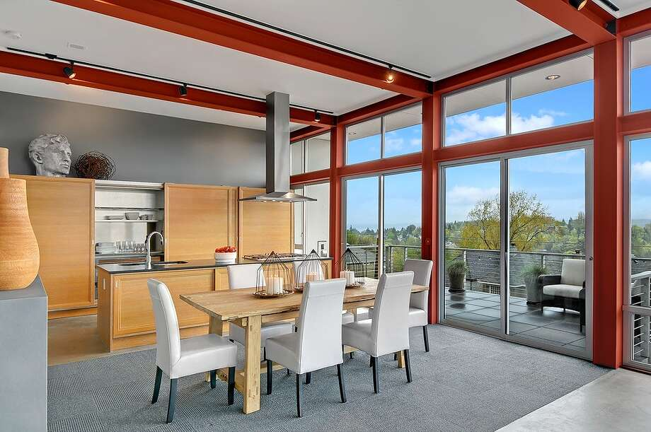 Dining room of 315 25th Ave. E. The 3,183-square-foot house, built in 2008, has three bedrooms, 2.75 bathrooms, a family room, walls of windows, concrete floors and walls, a roof deck with a fireplace, patios and a balcony on a 6,400-square-foot lot. It's listed for $1.395 million, although a sale is pending. Photo: Courtesy Phillip Belenky, Coldwell Banker Bain