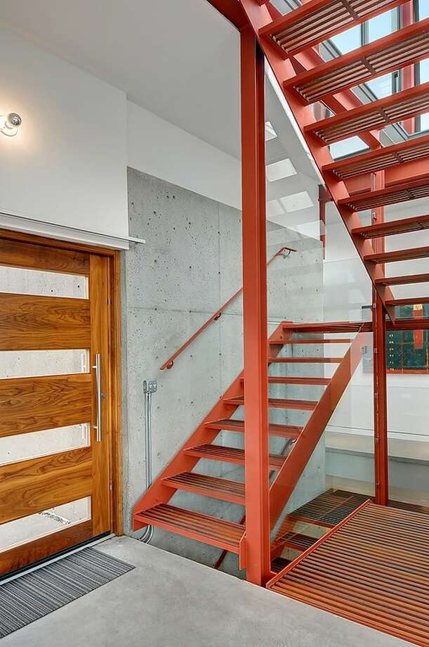 Entry of 315 25th Ave. E. The 3,183-square-foot house, built in 2008, has three bedrooms, 2.75 bathrooms, a family room, walls of windows, concrete floors and walls, a roof deck with a fireplace, patios and a balcony on a 6,400-square-foot lot. It's listed for $1.395 million, although a sale is pending. Photo: Courtesy Phillip Belenky, Coldwell Banker Bain