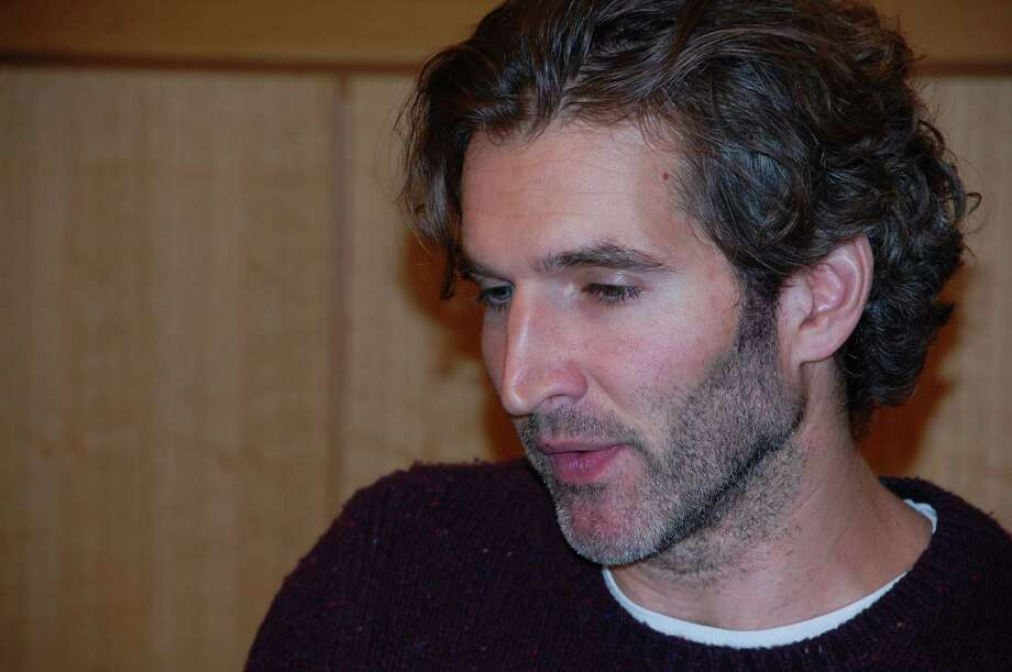 "David Benioff, author of ""City of Thieves,"" Darien's One Book, One Community selection this year, drew a large crowd at the Darien Library on Thursday, April 25, when he shared his experiences about writing the book. Jarret Liotta/For the Darien News Photo: Contributed"