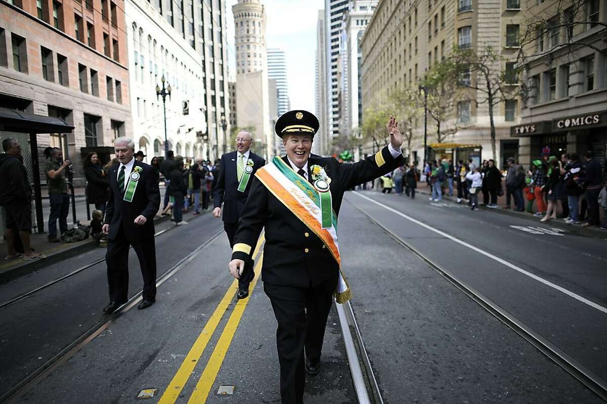 This years Grand Marshal, SF Fire Chief Joanne Hayes-White waves to the crowd as she marches down Market St. during the annual St. Patrick's Day Parade in San Francisco, Saturday March 16th, 2013.