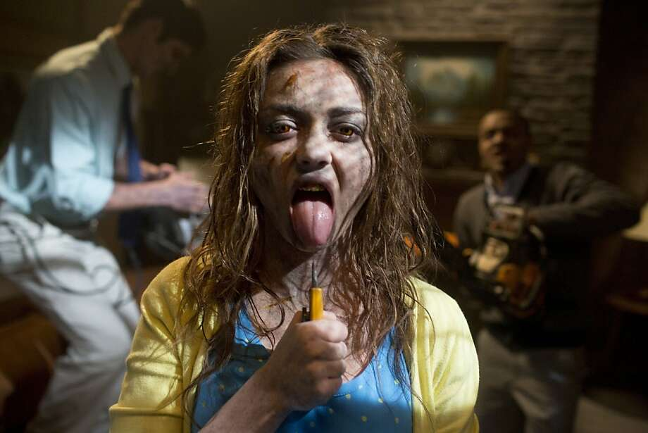 "Sarah Hyland in a scene from ""Scary Movie 5"": dismemberment and child abuse, all in good fun and fine for 13-year-olds? Photo: Peter Iovino, Associated Press"
