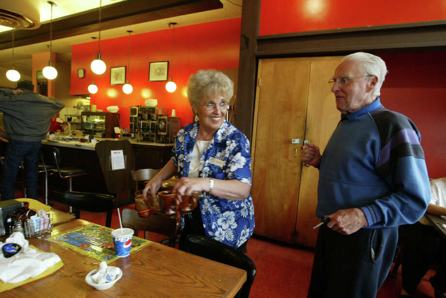 For decades, the Polynesian-themed Lani Kai Restaurant served regulars at the '60s-era Leilani Lanes bowling alley in Greenwood. It closed in 2005. Pictured is longtime waitress Louise Adams and former regular Wayne Luders. Photo: Scott Eklund / Seattle Post-Intelligencer