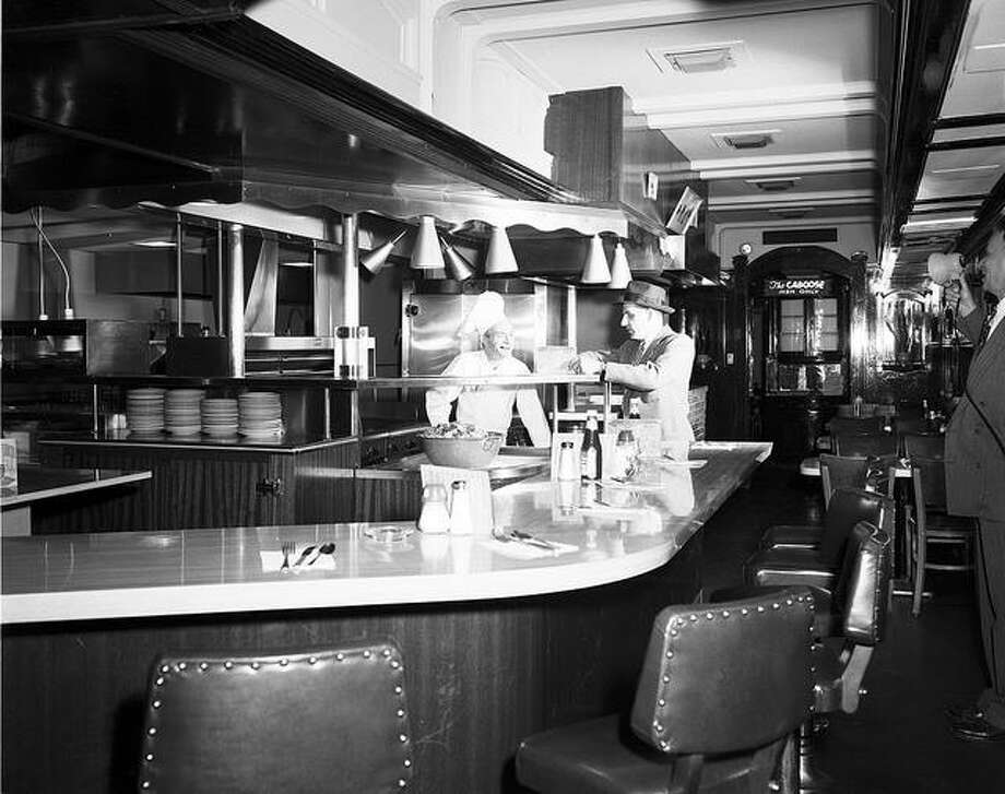 When Andy's Diner opened in 1949 in Sodo - inside a collection of rail cars - it quickly became a lunch scene for Boeing execs who came for drinks and char-broiled steaks. Photo: Seattle Muncipal Archives