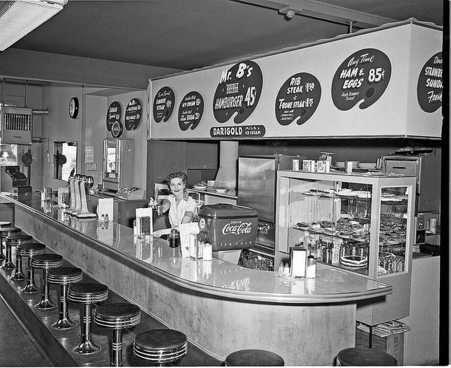 Mr. B's Hamburgers: No, we don't remember this place, identified as having been in West Seattle, by someone on the Seattle Municipal Archives Flickr site. But burgers for 45 cents and ham and eggs for 85 cents sound pretty good. Photo is from 1954. Photo: Seattle Municipal Archives