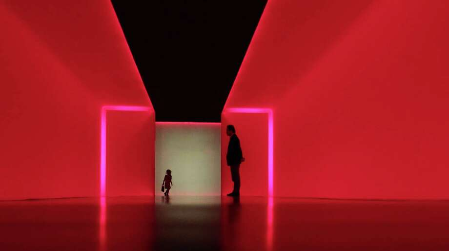 "Visitors walk within ""The Light Inside"" tunnel by James Turrell at the Museum of Fine Arts, Houston Tuesday, March 19, 2013, in Houston   ( James Nielsen / Houston Chronicle ) Photo: James Nielsen, Staff / © 2013 Houston Chronicle"