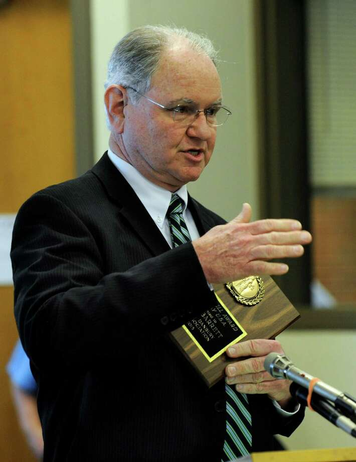 Peter Barrett, center, mock trial co-ordinator for Bethel Schools, is the winner of the Liberty Bell Award, presented during Law day ceremonies at Superio Court in Danbury, Conn. Friday, May 3, 2013. Photo: Carol Kaliff / The News-Times