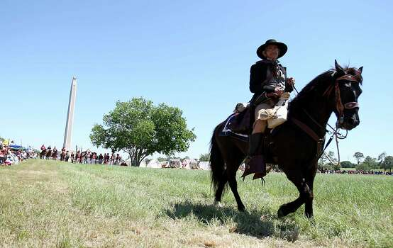 A reenactor dressed as a Texian soldier rides on the battlefield during the battle reenactment commemorating the 176th anniversary of the battle of San Jacinto at the San Jacinto Battleground, Saturday, April 21, 2012, in Houston.  ( Karen Warren / Houston Chronicle ) Photo: Karen Warren, Staff / © 2012  Houston Chronicle