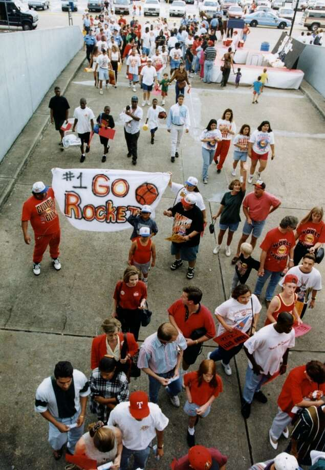 Rockets fans file into the Astrodome for a rally to celebrate the team's first NBA title. Photo: Chronicle File Photo