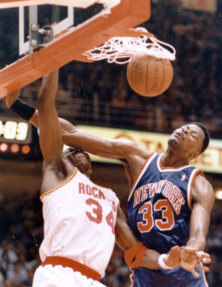 In your face: The Dream dunks on Patrick Ewing during the Game 6 win. Photo: Chronicle File Photo