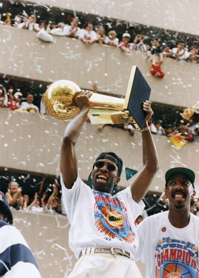 Kenny Smith hoists the Larry O'Brien trophy as fans cheer during the championship parade. Photo: Chronicle File Photo