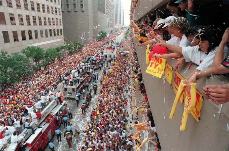 The Rockets ride firetrucks through downtown during the parade. Photo: Richard Carson, Chronicle File