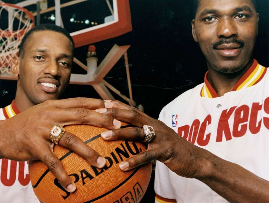 Otis Thorpe, left, and Hakeem Olajuwon sport their championship rings. A key member of the 93-94 title team, Thorpe was traded for Clyde Drexler during the 94-95 season. Photo: Chronicle File Photo