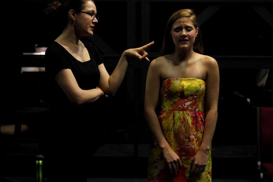 Kaitlin Hopkins (left) works with Lindsey Mader, 17, as Mader sings during a master class for finalists for a previous Las Casas Performing Arts Scholarship Competition. Las Casas Foundation will award $85,500 in scholarships at this year's competition on May 19. Photo: File Photo, San Antonio Express-News