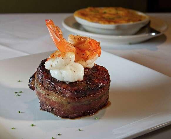 The Nueske Bacon Wrapped Filet with two jumbo grilled shrimp at Killen's Steakhouse Friday, Jan. 27, 2012, in Pearland.  ( James Nielsen / Chronicle ) Photo: James Nielsen, Staff / © 2011 Houston Chronicle