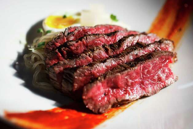 Grilled Flank, Sweet Potato Noodle, Dashi Broth, Daikon, and Red Chile at Chris Shepherd's restaurant Underbelly, Friday, Sept. 21, 2012, in Houston. ( Michael Paulsen / Houston Chronicle ) Photo: Michael Paulsen, Staff / © 2012 Houston Chronicle